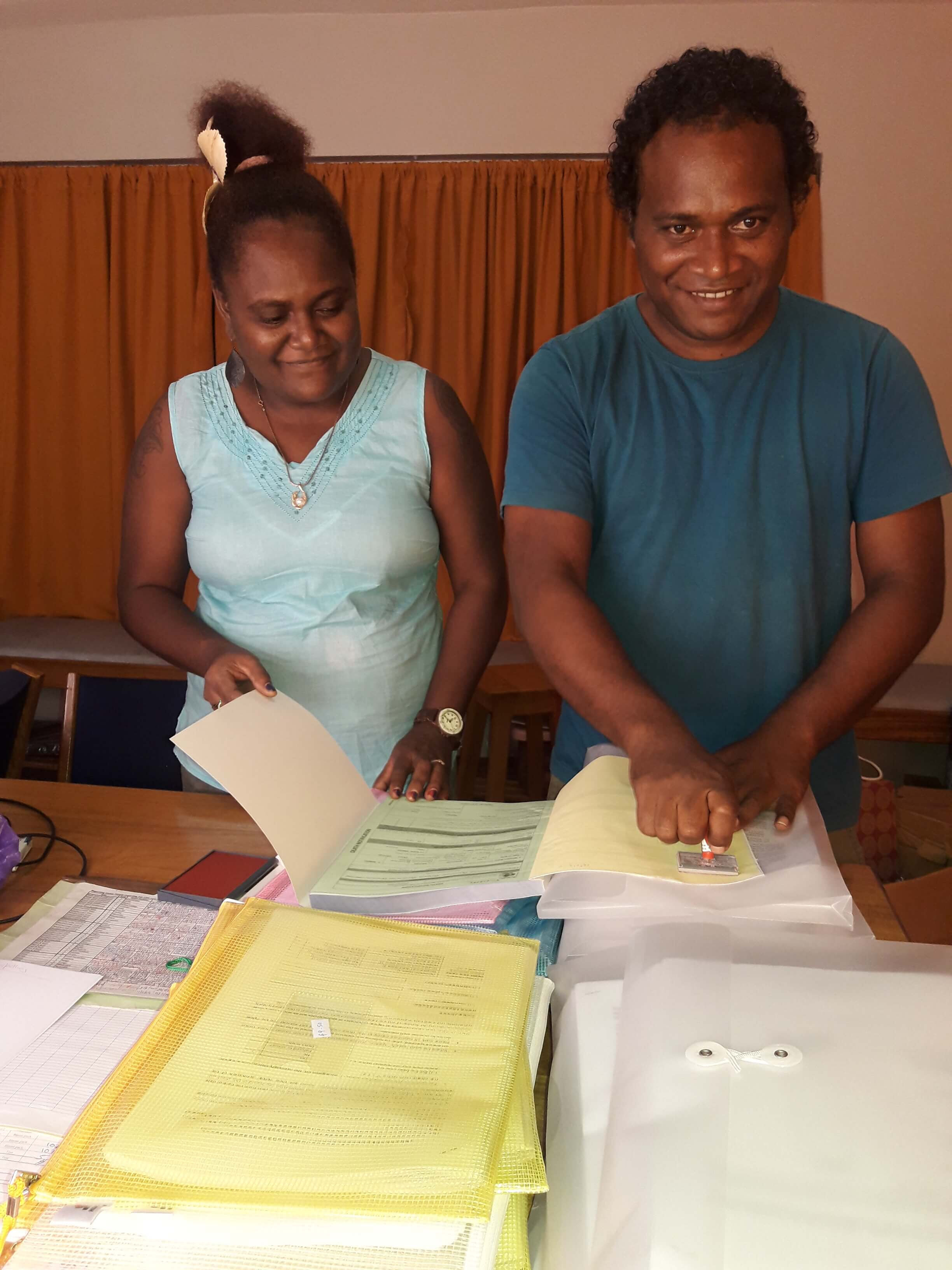 Solomon Islands government staff preparing paper-based verbal autopsy forms for distribution