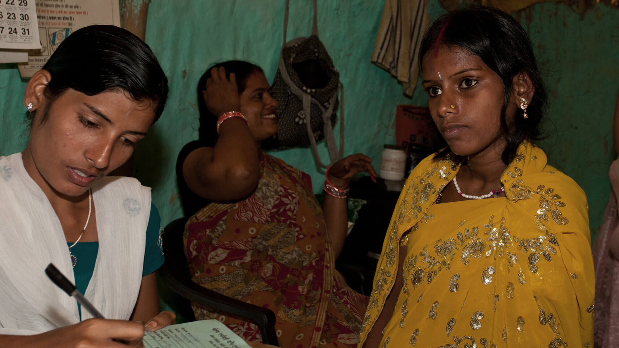 A woman conducts an interview at a medical facility in India.