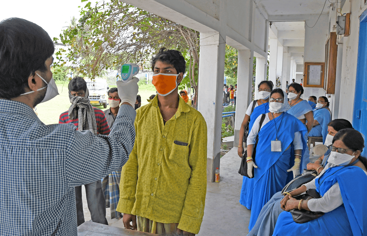 Image of people being tested for COVID-19 in India