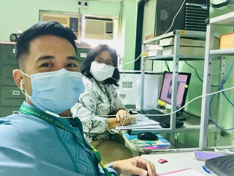 Joel Cris Patricio of West Visayas State University Medical Center, Iloilo City, Philippines, with his colleague during the online medical terminology training